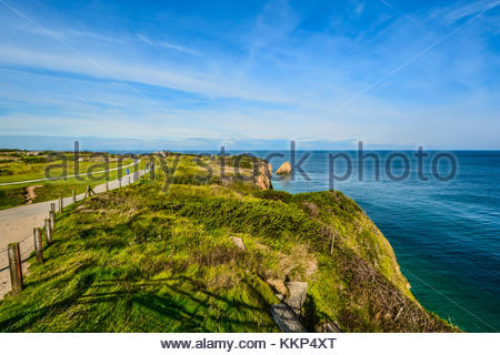 Pointe du Hoc and the memorial to fallen WWII soldiers on the coast of Normandy, in the English channel, between - Stock Photo