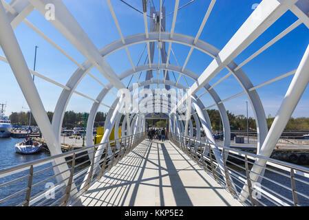 Steel movable footbridge over port channel of Slupia river mouth in Ustka - small Baltic Sea coastal town, Pomeranian Voivodeship of Poland