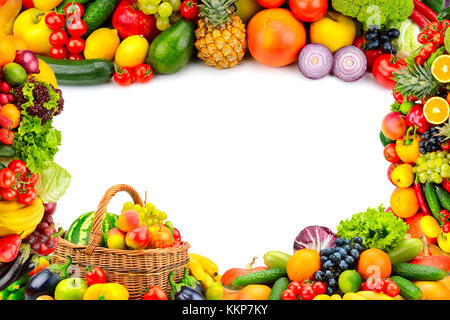 Frame from a variety of vegetables and fruits. Isolated space in the middle. - Stock Photo