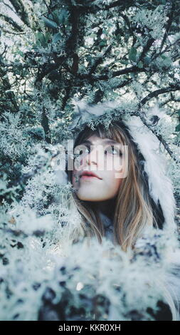 Young woman with a fur hat in a cold day - Stock Photo