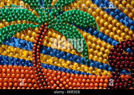 Light bulbs arranged topalms and lighting of a funfair stand. - Stock Photo
