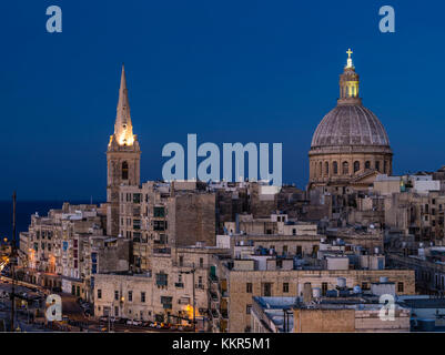 St Pauls Pro Cathedral and Carmelite's church, both landmarks of Valletta, Malta at blue hour - Stock Photo