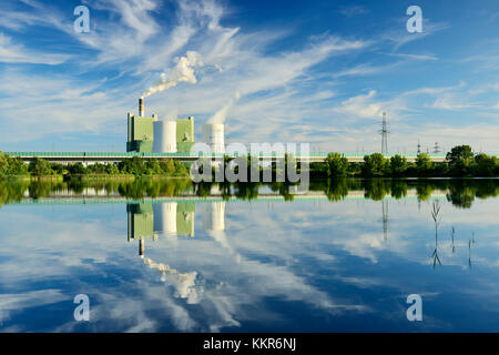 Germany, Saxony-Anhalt, Schkopau, brown coal power station is reflected in pond - Stock Photo