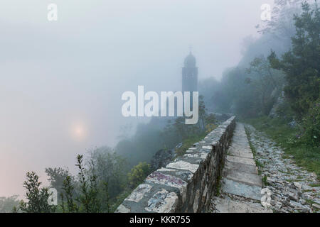 Fortifications of Kotor, part of the Natural and Culturo-Historical Region of Kotor, Montenegro, in a foggy morning - Stock Photo