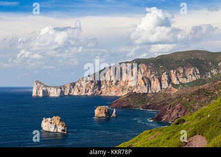 View of the coast near Masua, in the distance the Pan di Zucchero reef. Masua, Sulcis-iglesiente, Iglesias, Sardinia, - Stock Photo