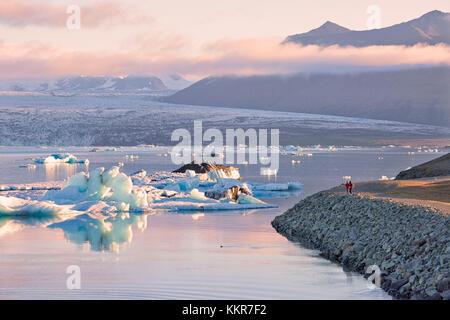 Iceberg in Jokulsarlon Glacier Lagoon during a sunrise, Austurland, Eastern Iceland, Iceland - Stock Photo