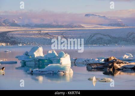 Icebergs in Jokulsarlon Glacier Lagoon during a sunrise, Austurland, Eastern Iceland, Iceland - Stock Photo
