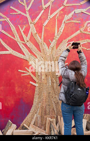 Personal hopes, messages & prayers written on slats of wood for the shape of a tree at the Union Square pre-Christmas - Stock Photo