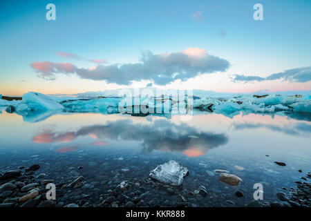 Jokulsarlon, Eastern Iceland, Iceland, Northern Europe. The iconic little icebergs lined in the glacier lagoon during a sunrise