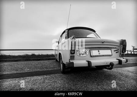 An old Trabant on the coast of Eastfrisia - Stock Photo