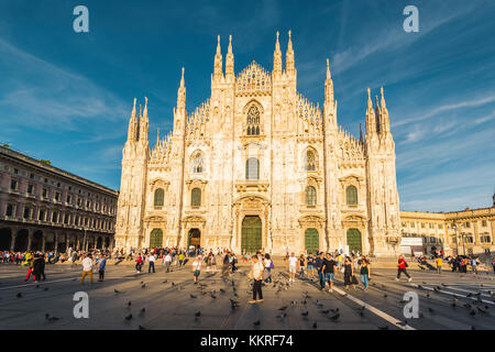 Milan, Lombardy, Italy. The facade of the Milan's Cathedral (Duomo) at sunset. - Stock Photo