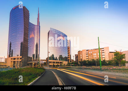 Milan, Lombardy, Italy. Light trails in Porta Nuova district at dusk. - Stock Photo