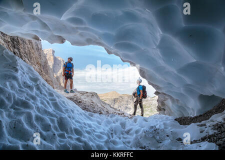 Italy, South Tyrol, Hochpustertal, Sexten. Snow cave in the summer season along the Alpinisteig / Strada degli alpini - Stock Photo