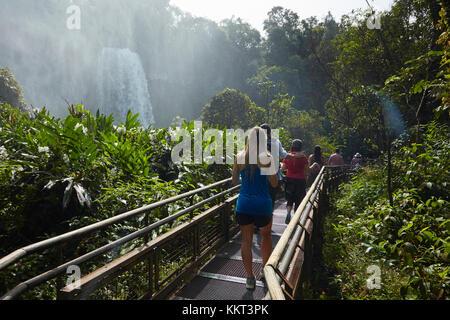 Tourist on walkway by Iguazu Falls, Argentina, South America