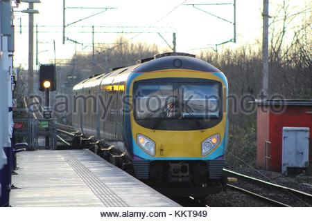 East Didsbury, Manchester, UK (December 2017) A Diesel train seen passing a platform whilst running in passenger - Stock Photo