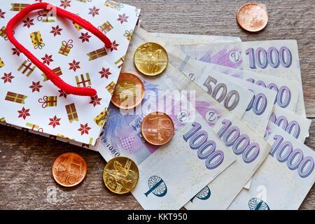 české peníze - bankovky jako dárek / Czech currency - banknotes in gift bags - Stock Photo