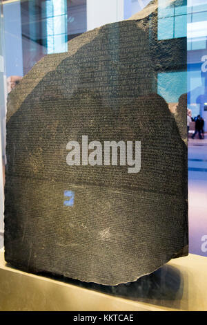 The Rosetta Stone (made using granodiorite stone) on display in the British Museum, London, UK. (92) - Stock Photo