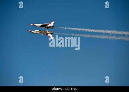 USAF F-16 Thunderbirds performing a Reflection Pass at Gowen Thunder air show on October 14 2017 - Stock Photo