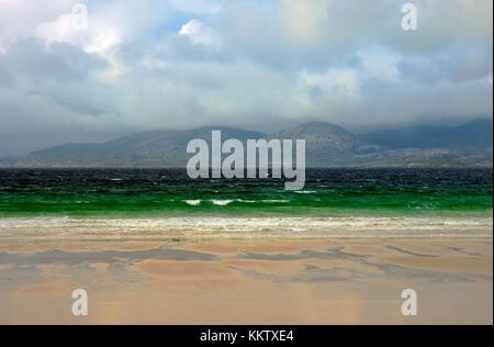 Island of Taransay in the Outer Hebrides seen across the Sound of Taransay from beach at Luskentyre, Isle of Harris, - Stock Photo