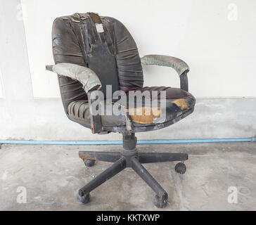 black Office chair old damage leather and dirty, time to replace the office chair.(select focus chair) - Stock Photo