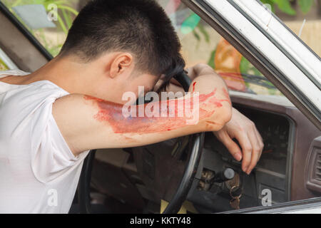 patient Injury upper arm in car, victim in a crashed vehicle,Wait physician assist patient in emergency rescue situations, - Stock Photo