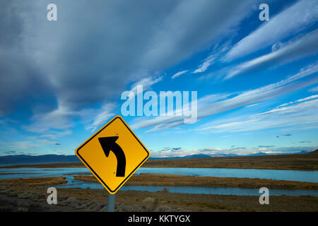 Road sign and La Leona River, Patagonia, Argentina, South America - Stock Photo