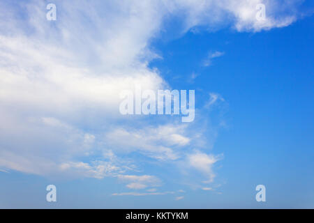 blue sky background is covered by white clouds.(may be used as background) - Stock Photo