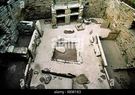 Skara Brae stone age village 3100 BC, Bay of Skaill, Mainland, Orkney, Scotland. House interior, box beds, hearth - Stock Photo