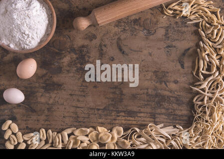 Mixed fresh italian pasta on wood table in  frame composition - Stock Photo