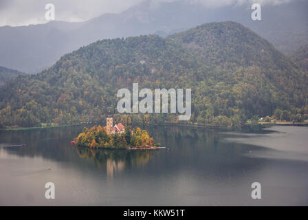 Bird's eye view of Lake Bled and island on a rainy day - Stock Photo