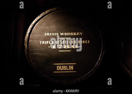 Old wooden barrel full of Dublin's Irish whiskey - Stock Photo