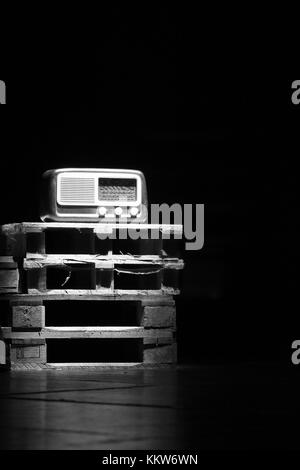 An old radio vintage over wooden pallets. - Stock Photo