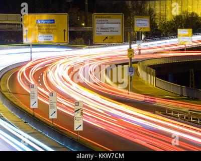 car traffic at night in ulm, germany - Stock Photo