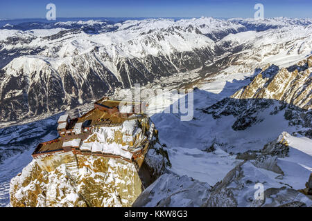 Bird's eye view of Aiguille du Midi terraces in Mont Blanc, Chamonix, offering amazing view of French, Swiss, Italian - Stock Photo