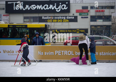 Family ice-skating on outdoor rink in Belgrade, Serbia - Stock Photo