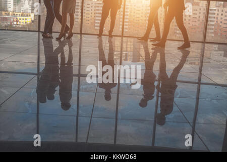 Silhouettes of business people in conference room - Stock Photo