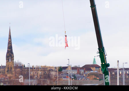 Glasgow, Scotland, UK. 2nd Dec, 2017. Santa enjoys a 160ft crane bungee jump in Glasgow. Credit: Skully/Alamy Live - Stock Photo