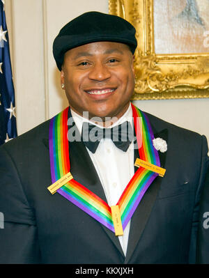 LL COOL J, one of he five recipients of the 40th Annual Kennedy Center Honors with his award as he poses for a group - Stock Photo