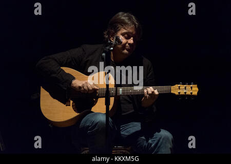 Vigevano, Italy. 2st December, 2017. Cristiano De Andre plays guitar during a live performance. Credit: Luca Quadrio/Alamy - Stock Photo