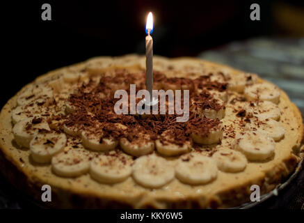 Homemade banana chocolate cheesecake for a birthday girl! - Stock Photo