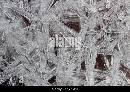 Naturally formed patterns in a thin sheet of ice--pure, amazing, intricate. - Stock Photo