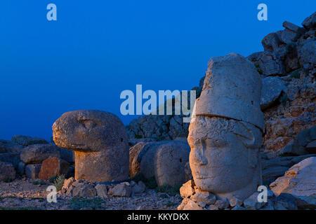 Statues on top of the Nemrut Mountain, at the twilight, Adiyaman, Turkey. - Stock Photo