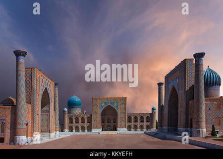 Registan square in Samarkand, Uzbekistan with dramatic skyline. - Stock Photo