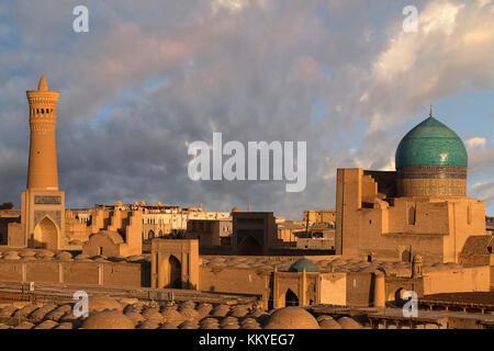 Poi Kalon Mosque and Minaret at the sunset, in Bukhara, Uzbekistan. - Stock Photo