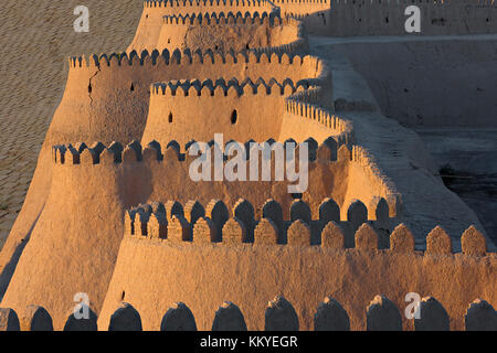 City walls of the ancient city of Khiva in Uzbekistan, at the sunset. - Stock Photo