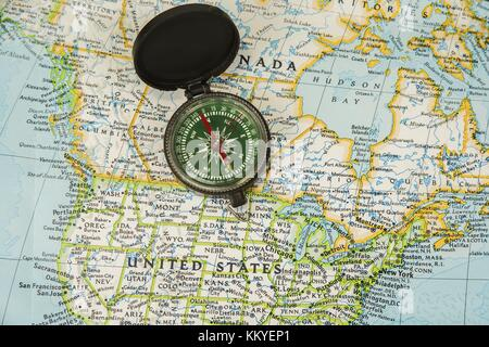 Compass on a map pointing at United Kingdom and Ireland planning a