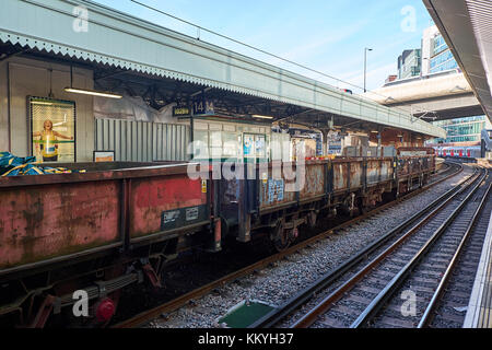 LONDON CITY - DECEMBER 26, 2016: Wagons on a freight train parked at Paddington Station for picking up scrap - Stock Photo