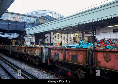 LONDON CITY - DECEMBER 26, 2016: Freight train with wagons parked at Paddington Station for picking up scrap - Stock Photo