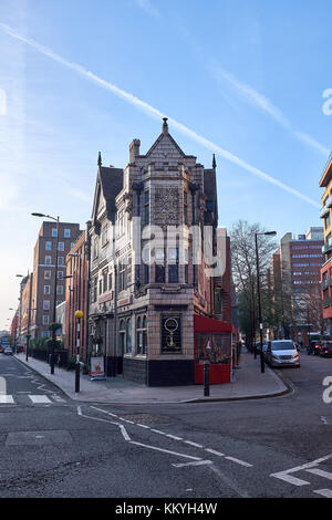LONDON CITY - DECEMBER 26, 2016: Old narrow V-shaped corner building in old style with decorations - Stock Photo