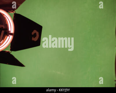 Real empty green screen in photo studio with luminous lamp - Stock Photo